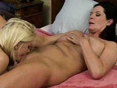 Buxom cougar trains young blond more about lezzy sex