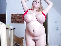 Chubby light-haired with ample fun bags and fat coochie taking off her bathing suit