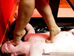 Nasty whore is walking all over him and squeezing her nutsack