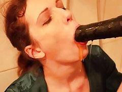 Crazy super-bitch is getting face smashed with a giant ebony cable on