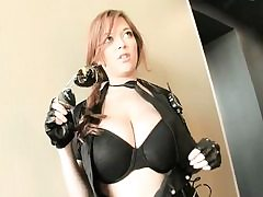 Wild gal wearing leather outfit acting like a real slut on camera