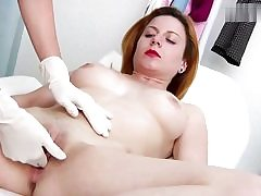 Horny red haired babe gets her cunt hole examined on a gyno chair